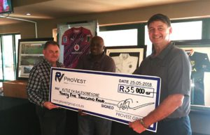 Provest Board Members handing a cheque over